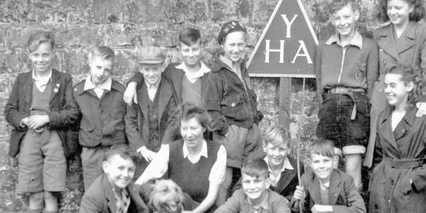 Old black and white image of a Group of young people at YHA
