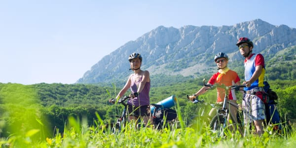 Three adults on a group mountain biking holiday with YHA