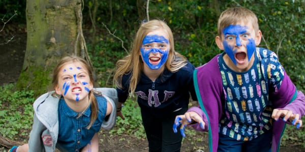 3 school children with face paint on a YHA history school trip