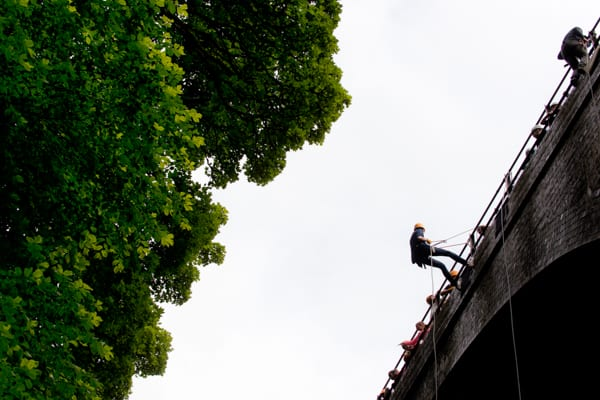 Abseiling down a bridge