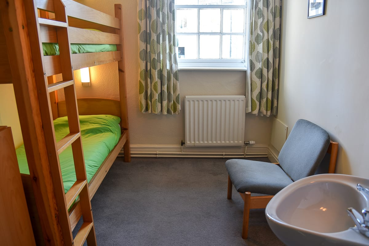 Dorm room with bunk bed