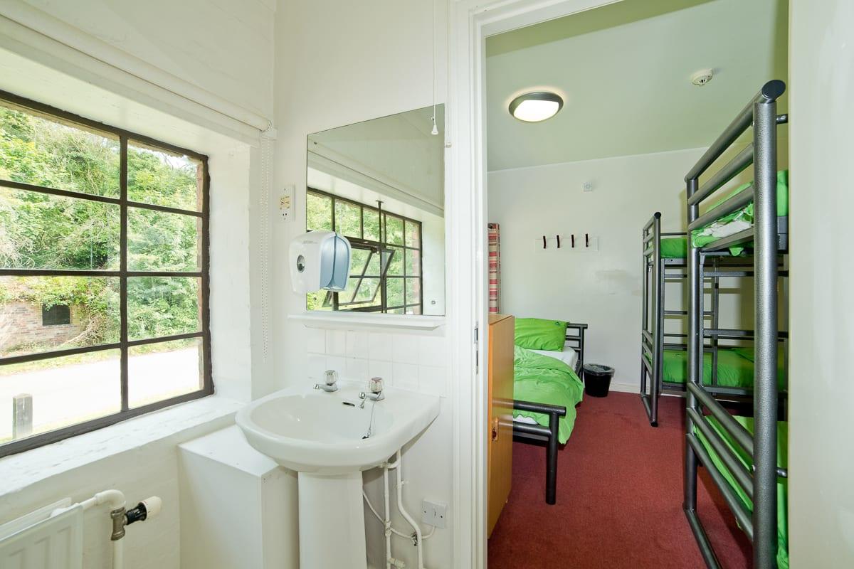 Bunk beds and sink in dorm room