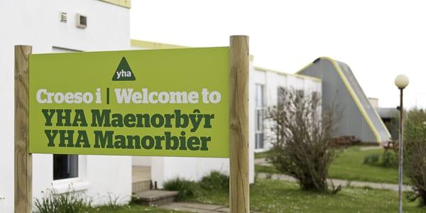 YHA Manorbier Welcome Sign