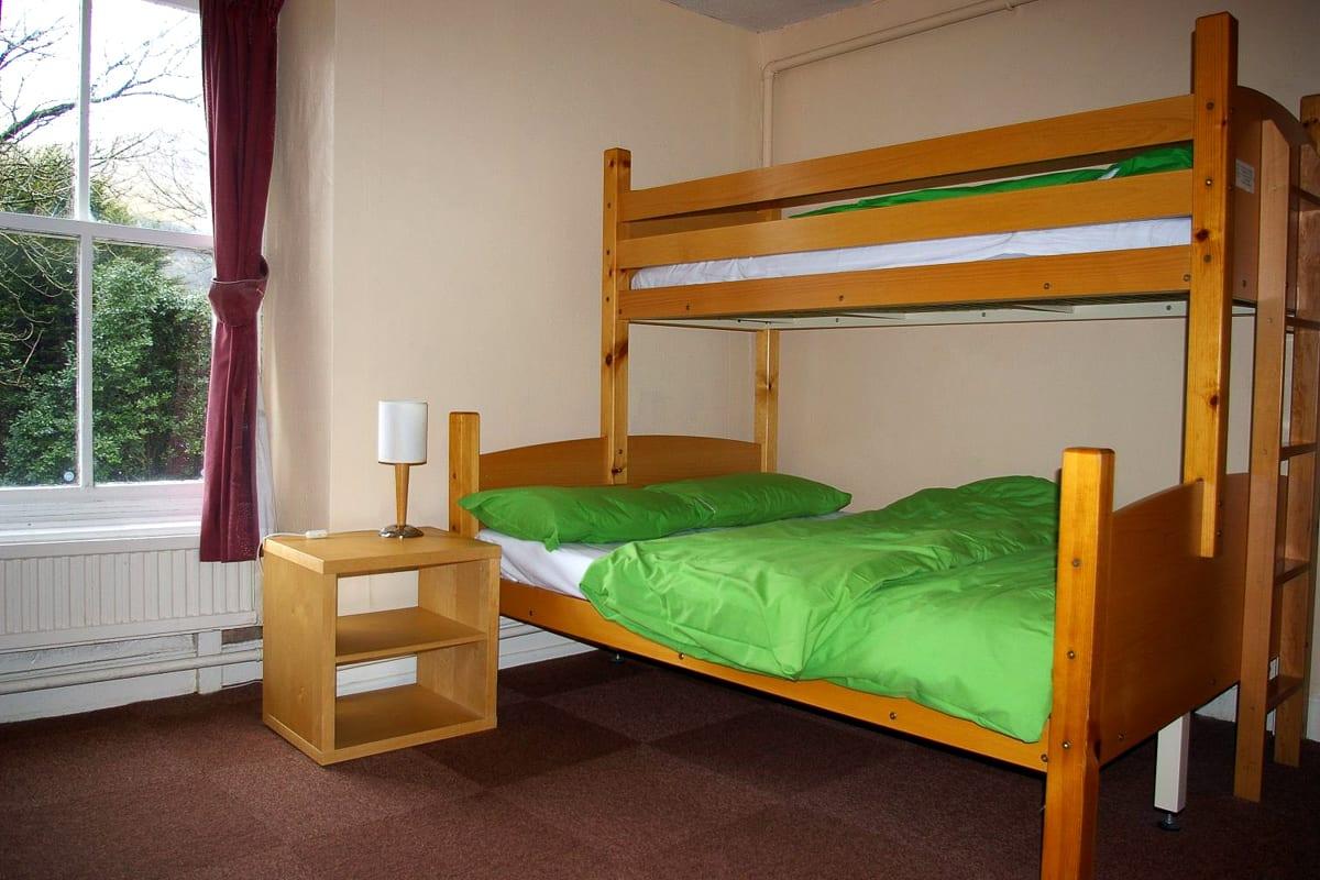 Double bed in dorm room
