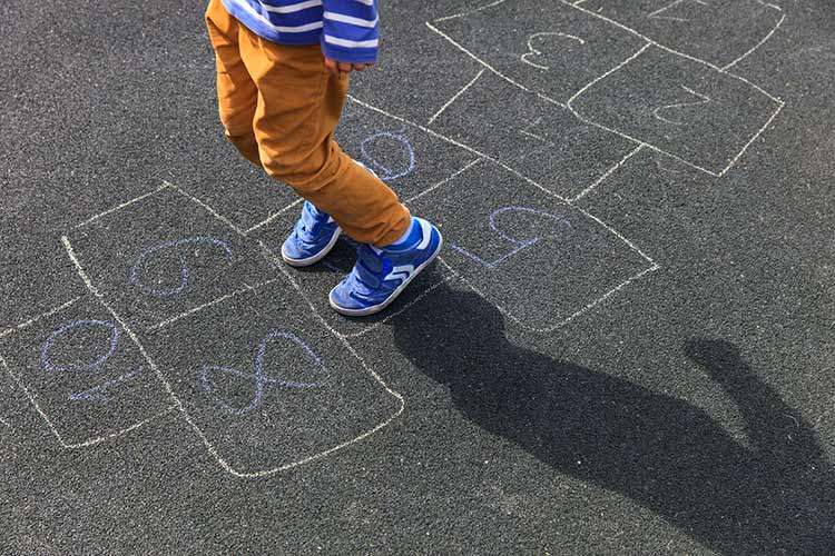 Child doing a hopscotch