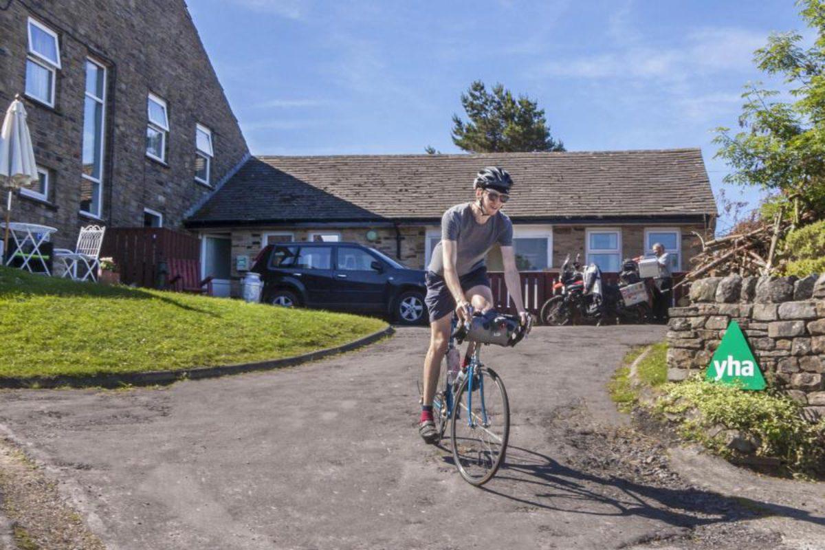 Cyclist by YHA Hawes entrance