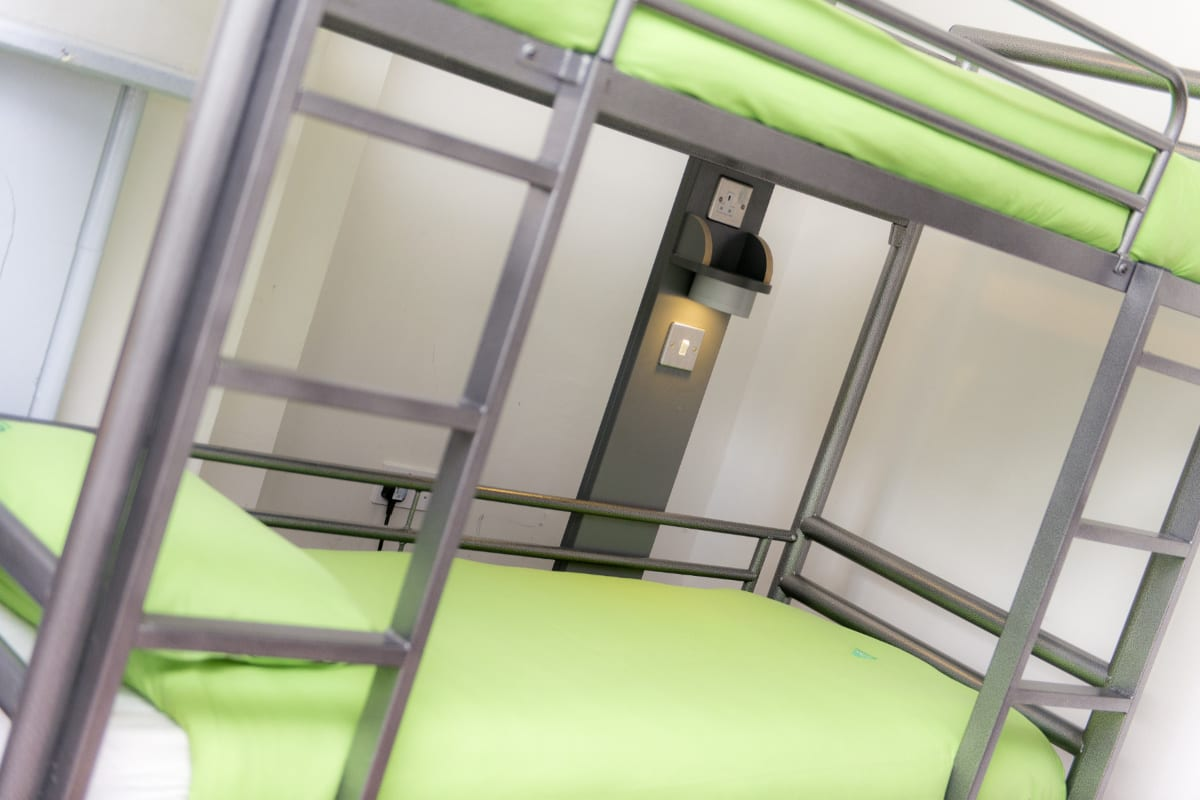 Bunk bed with green bedding