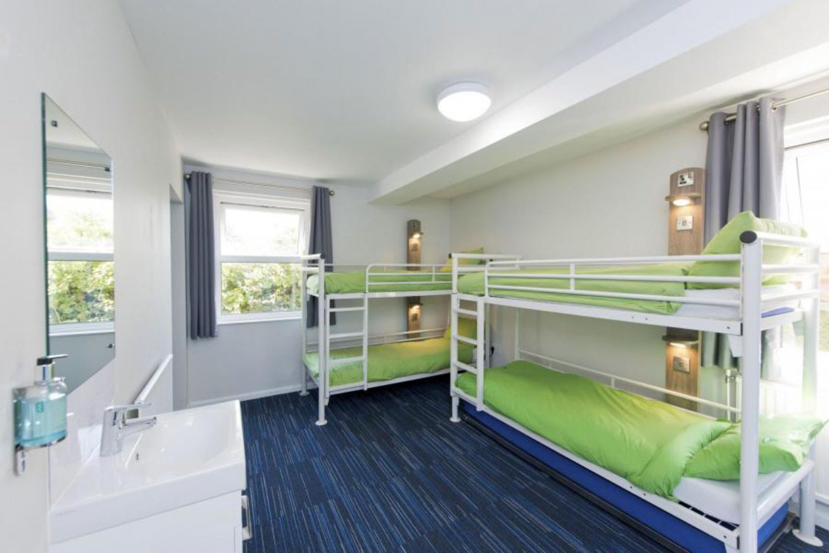 YHA Swanage bedroom with two bunkbeds and a sink