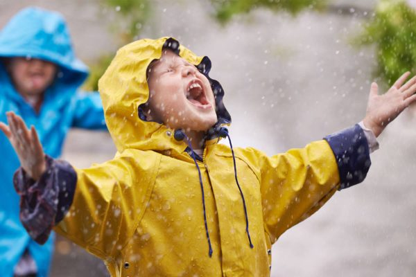 Child standing in the rain