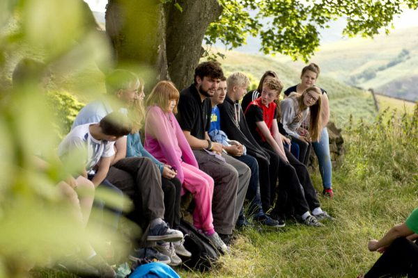 Group of under 26-year-olds sitting outdoors